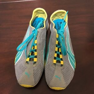 Grey, teal, and yellow puma shoes